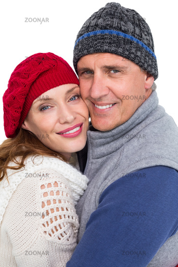 Happy couple in warm clothing hugging