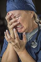 Agonizing Crying Female Doctor or Nurse