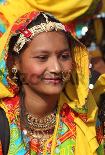 Portrait of smiling Indian girl at Pushkar camel fair