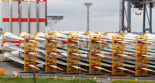 Many rotor blades for huge wind turbines in harbour