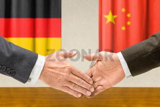 Representatives of Germany and China shake hands