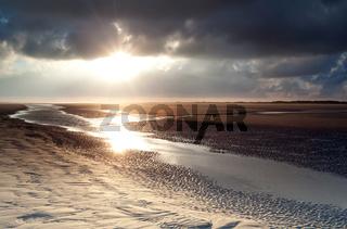 sunrise over sand beach on North sea