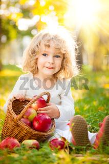 Child having picnic in autumn park