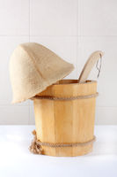 Wooden bucket with ladle for the sauna on white background