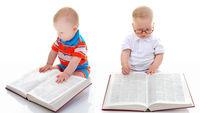 Little smart boy reads a big book.