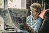 reading Senior Woman