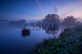 misty sunrise over lake