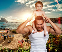 Loving father with daughter on shoulders against beach background. Vacation with children, conceptual photo