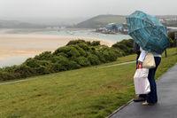 Mature couple under an umbrella