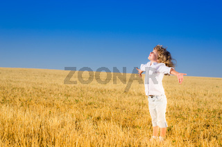 Child in autumn field