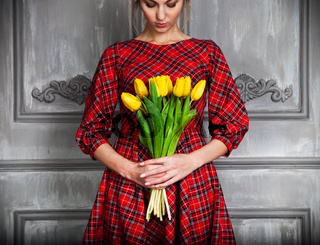 Romantic woman with blond hair with tulip bouquet