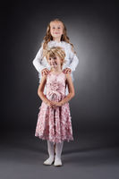 Image of beautiful little sisters posing in studio