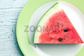 sliced watermelon on kitchen table