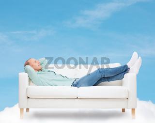 smiling man lying on sofa