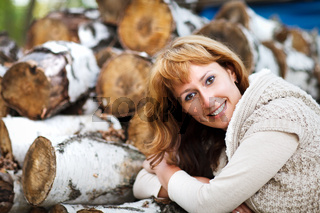 Portrait of a smiling red haired woman in autumn day