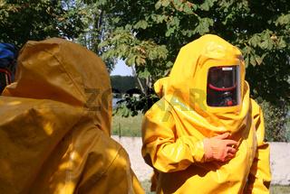 Man iin yellow chemical suit
