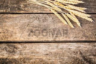 Autumn wheat on old wood texture