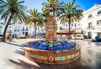The main square in Vejer de la Frontera is Plaza de Espana, featuring a beautiful fountain with colorful ceramic tiles.