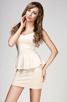beautiful woman in beige dress