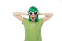 Fun young girl in a green wig and sunglasses