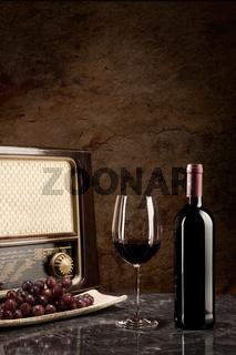 Enjoying wine and listening to the radio