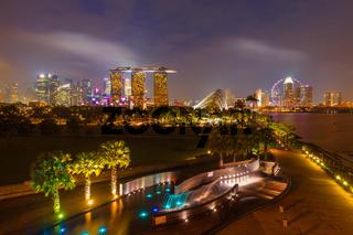 Tracel background of Singapore skyline illumintaed in the evening twilight