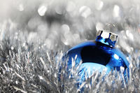 blue christmas ball on silver background