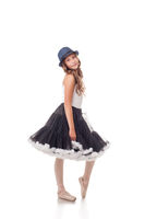 Pretty ballet dancer posing in dress and hat