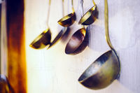 Ladles hanging on a white wall