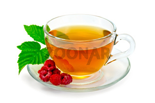 Tea with raspberries in a cup