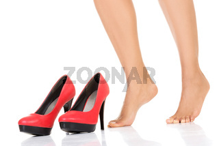 Female legs and red heels.