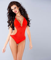 Sexy sensual brunette posing in red swimsuit
