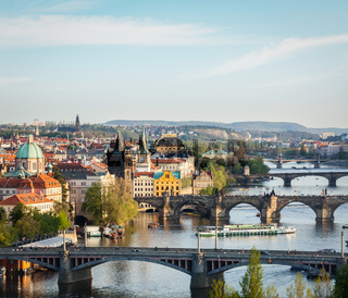 Travel Prague concept background - elevated view of bridges over Vltava river from Letná Park. Prague