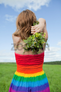 girl with a bouquet of wild flowers
