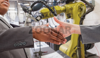 Composite image of businessman going shaking a hand