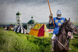 Armored knight on warhorse over old medieval castle and camp