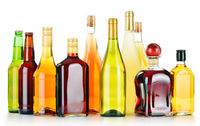 Bottles of assorted alcoholic beverages isolated on white background
