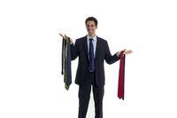 Man chooses a tie from