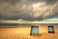 roofed wicker beach chairs