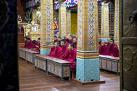 Buddhist monks preparign for the evening prayers