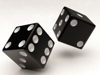 two black dices falling