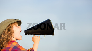 Kid shouting through megaphone