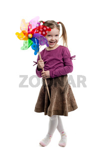 Little girl holding colorful windmill isolated