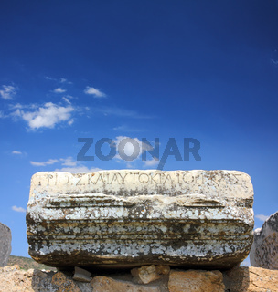 fragment of ancient ruins with lettering