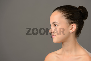 Teenage girl skin care cosmetics looking away