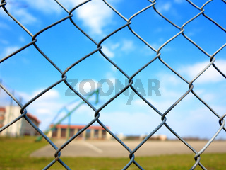 Metal mesh with blur basketball court background