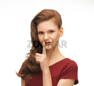woman showing silence gesture
