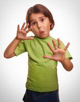 frightened child little girl experiences terror locked hands sur