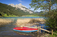 Lake Haldensee and red boat in Austria