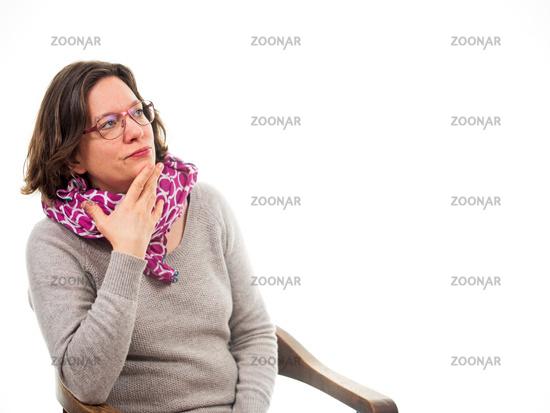 Woman looks upwards thinking